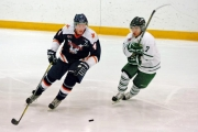 Arie Postmus of the Nitehawks skates away from Leaf forward Carsen Willans during KIJHL action in Nelson.
